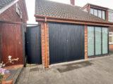 black garage door RAL paint code 7021